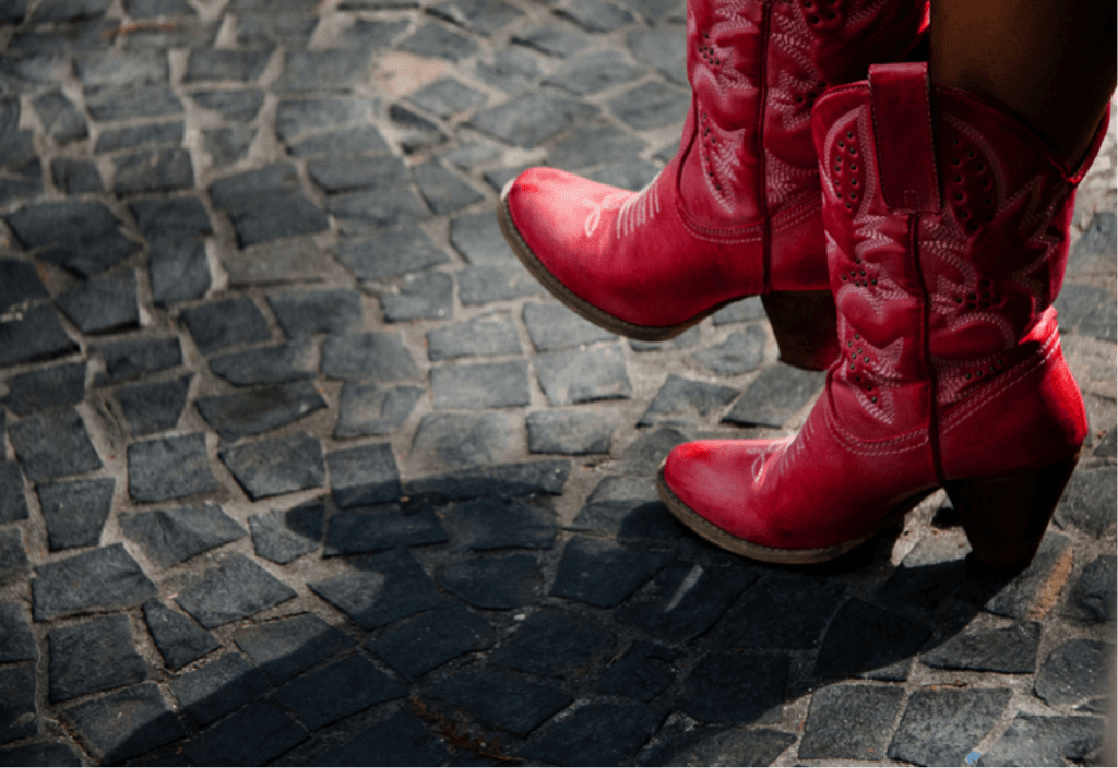 A woman's red boots that match fall 2017 fashion trends