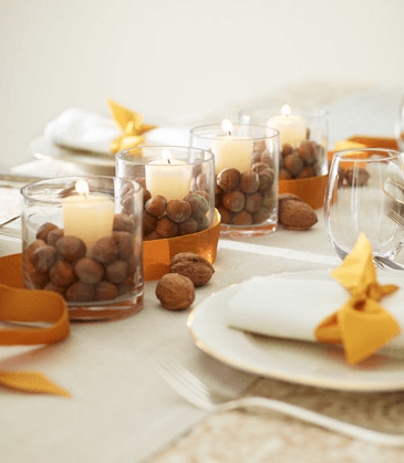Candles and acorns as a homemade Thanksgiving centerpiece