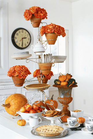 Tall arrangement of pie and flowers as DIY Thanksgiving centerpiece
