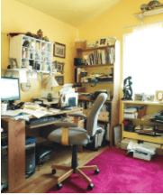 Cluttered home office space